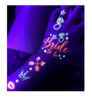 Assortment of glow in dark temporary tattoos on a hand