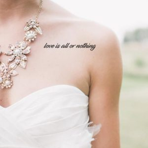 Love quote temporary tattoo on bride's décolletage