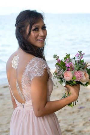 Bride sporting metallic temporary tattoo on her back and a posy in her hand